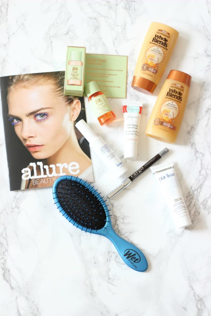 Allure Beauty Box August 2016 Review | Pixi Glow Tonic, Wet Brush, Freeze 24-7 Anti Aging Eye Serum, PurLisse Blue Lotus Balancing Moisturizer, Supergoop Defense Refresh Setting Mist SPF 50, Caro Swimmables Eye Pencil Pebble Beach