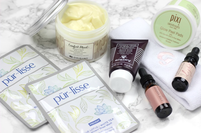 Winter Skin Care Must Haves | PurLisse Blue Lotus and White Tea Treatment Mask, Origins Comfort Mood Body Souffle, Sisley Creme Rose Mask, PIXI Glow Peel Pads, Josie Maran Argan Oil Light
