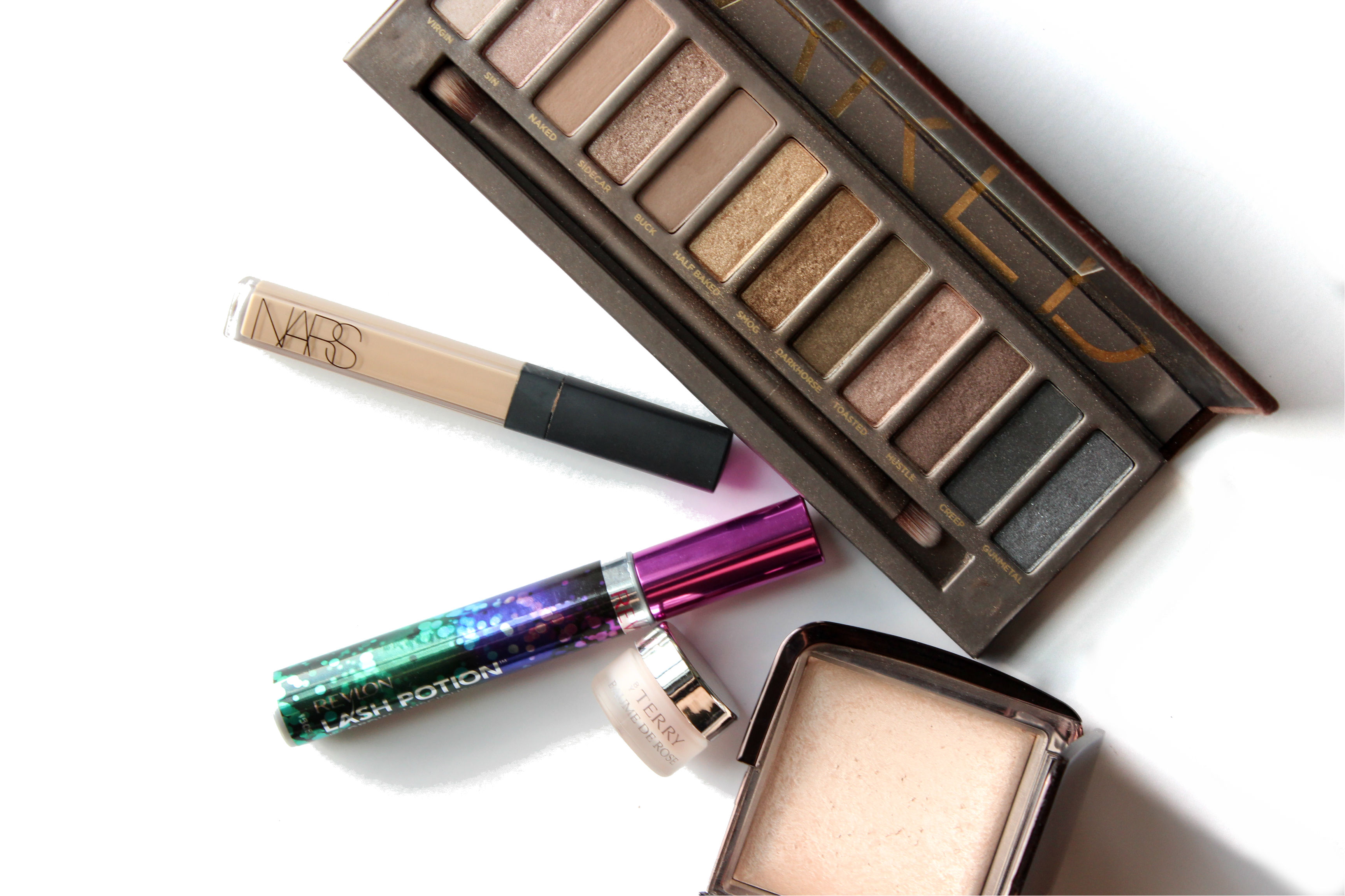 September Makeup Beauty Favorites | Brighterdarling.com Urban Decay Naked Palette NARS Radiant Creamy Concealer Revlon Lash Potion byTerrm Baume De Rose Hourglass Luminous Light