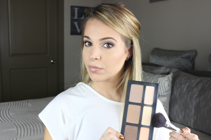 Using the highlight shade in the Kat Von D Shade Light Contour Palette to finish the look