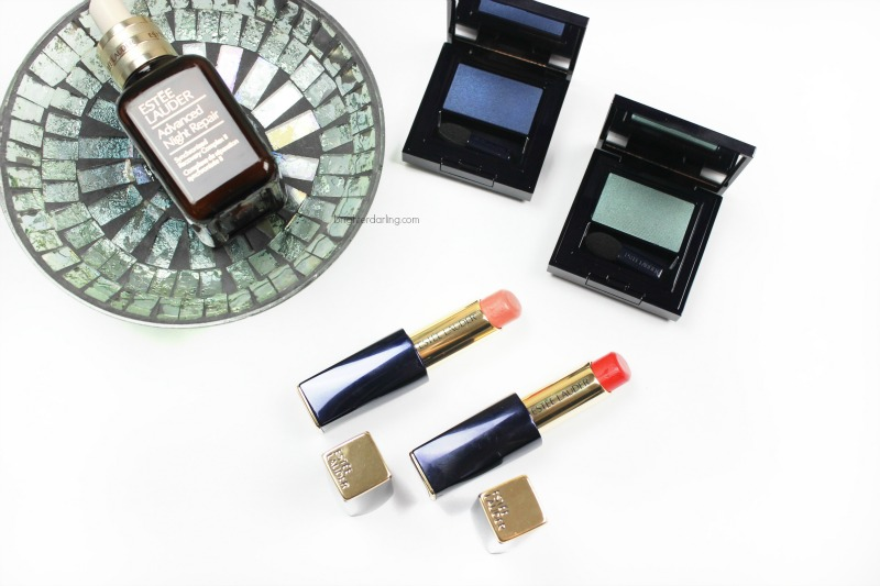 Image of Estee Lauder Pure Color Envy Sculpting Shine Lipsticks in Innocent and Empowered, Estee Lauder Pure Color Defining Eyeshadow Hyper Teal and Blue Fury and Advanced Night Repair Serum on a small dish.