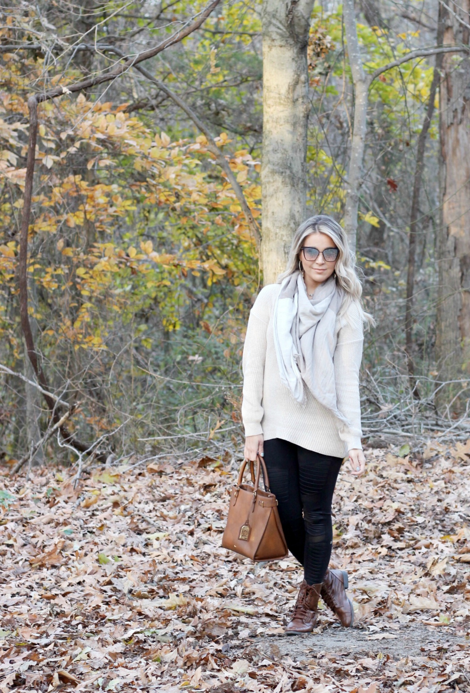 Oatmeal Cream Beige Tunic Sweater with Black Moto Leggings and Beige Checkered Scarf | Sweaters For Leggings