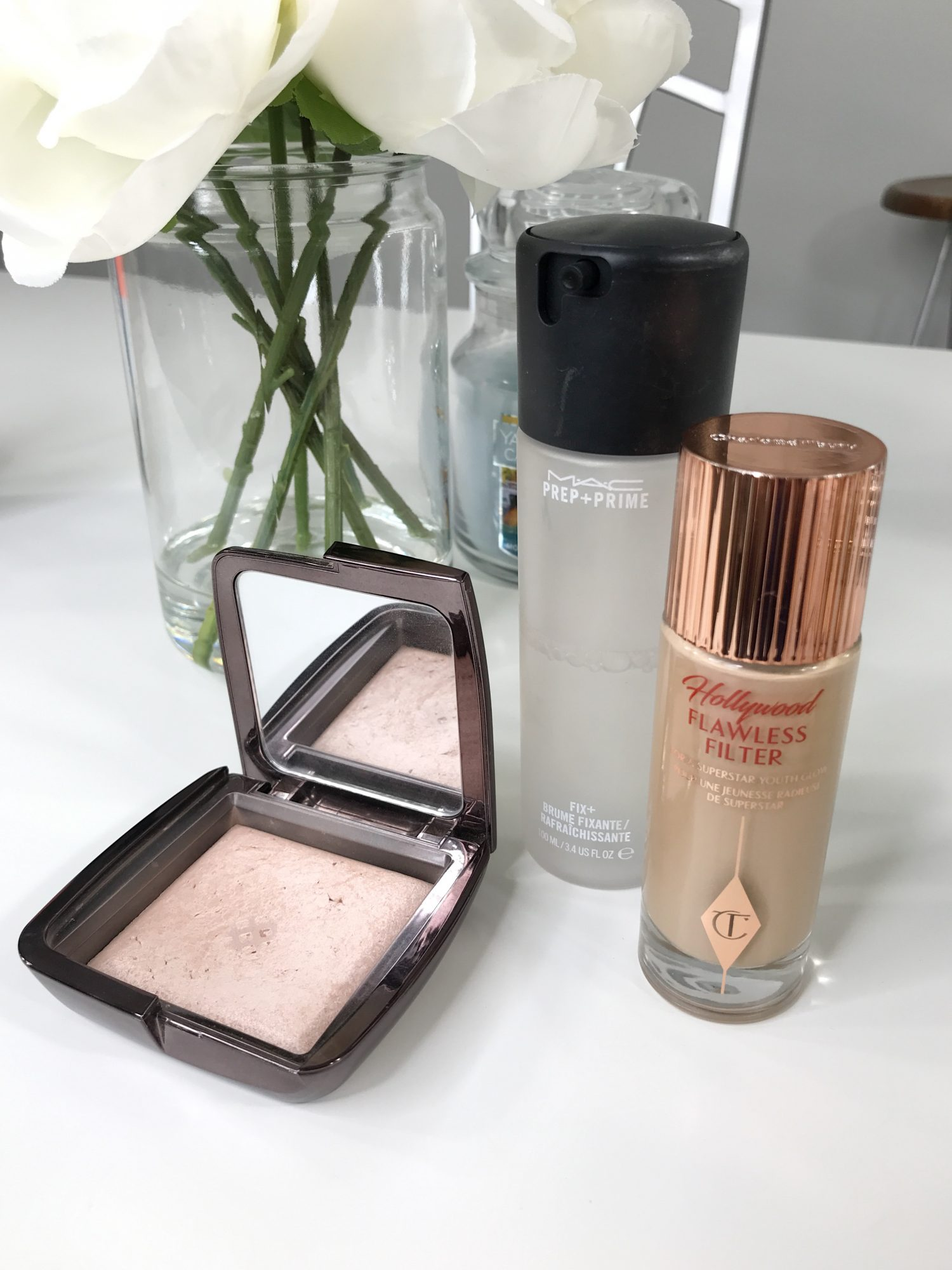 First Trimester Beauty Essentials | First Trimester Beauty Must Haves Hourglass Luminous Light, MAC Fix Plus Spray, Charlotte Tilbury Hollywood Flawless Filter