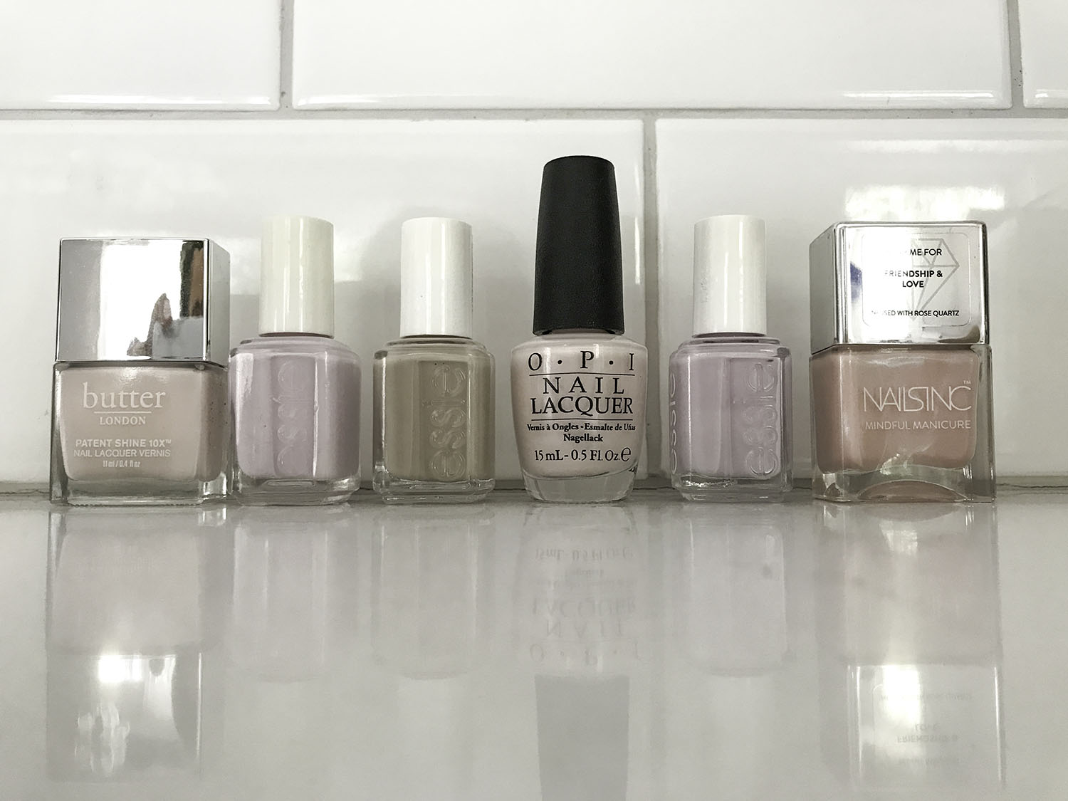 6 Neutral Nail Polish Colors  | Butter London Twist and Twirl, Essie Fiji, Essie Sand Tropez, OPI Let Me Bayou A Drink, Essie Go Ginza, OPI Humidi-Tea